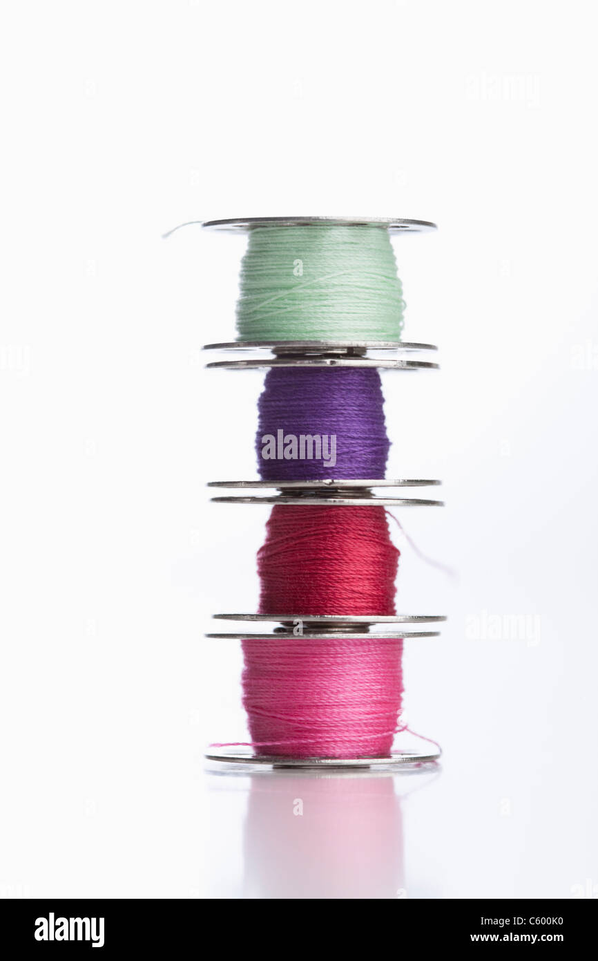 Stack of multi colored threads - Stock Image