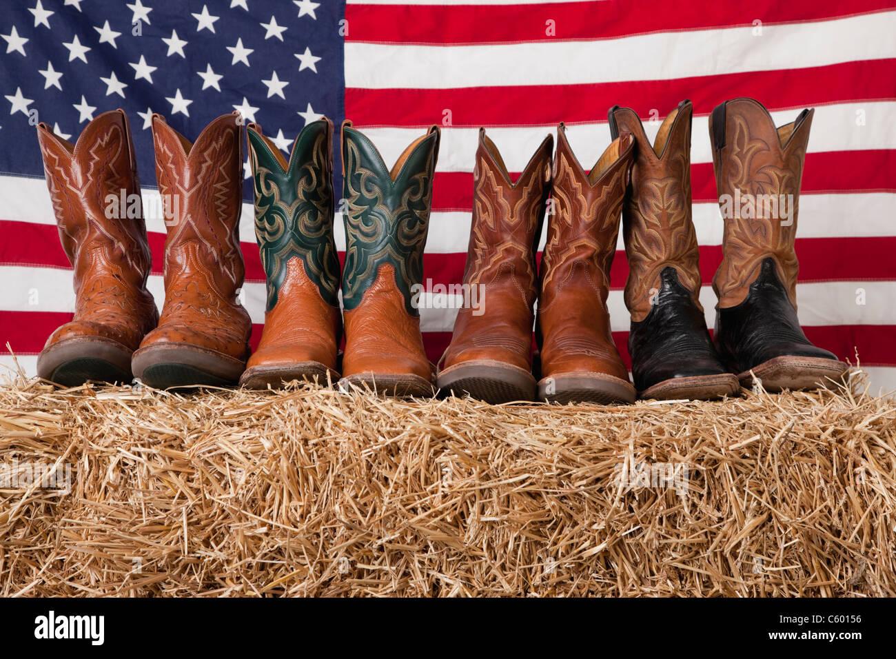 USA, Illinois, Metamora, Row of cowboy boots on haystack