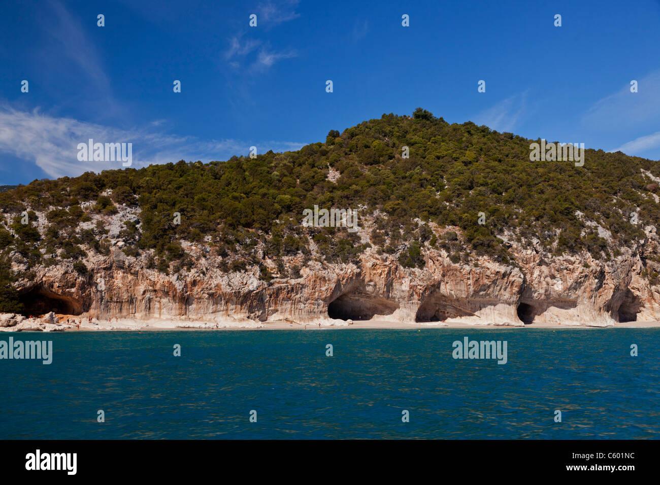 Cala Luna Sardinia Italy landscape ocean sky blue people Hoehle cave - Stock Image