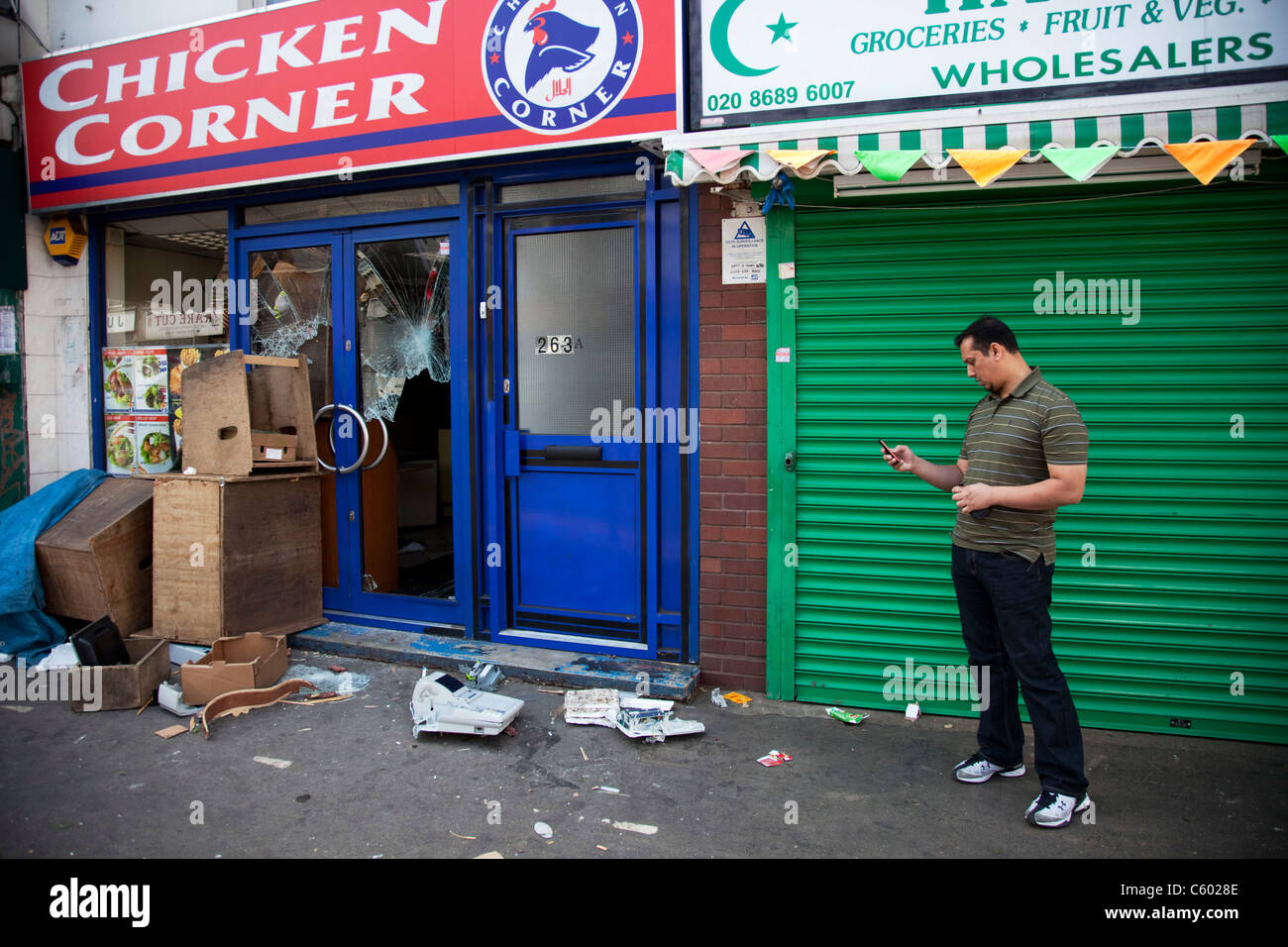 Looted and smashed up shop fronts along London Road in Croydon. The day after rioting took place in Croydon in South - Stock Image