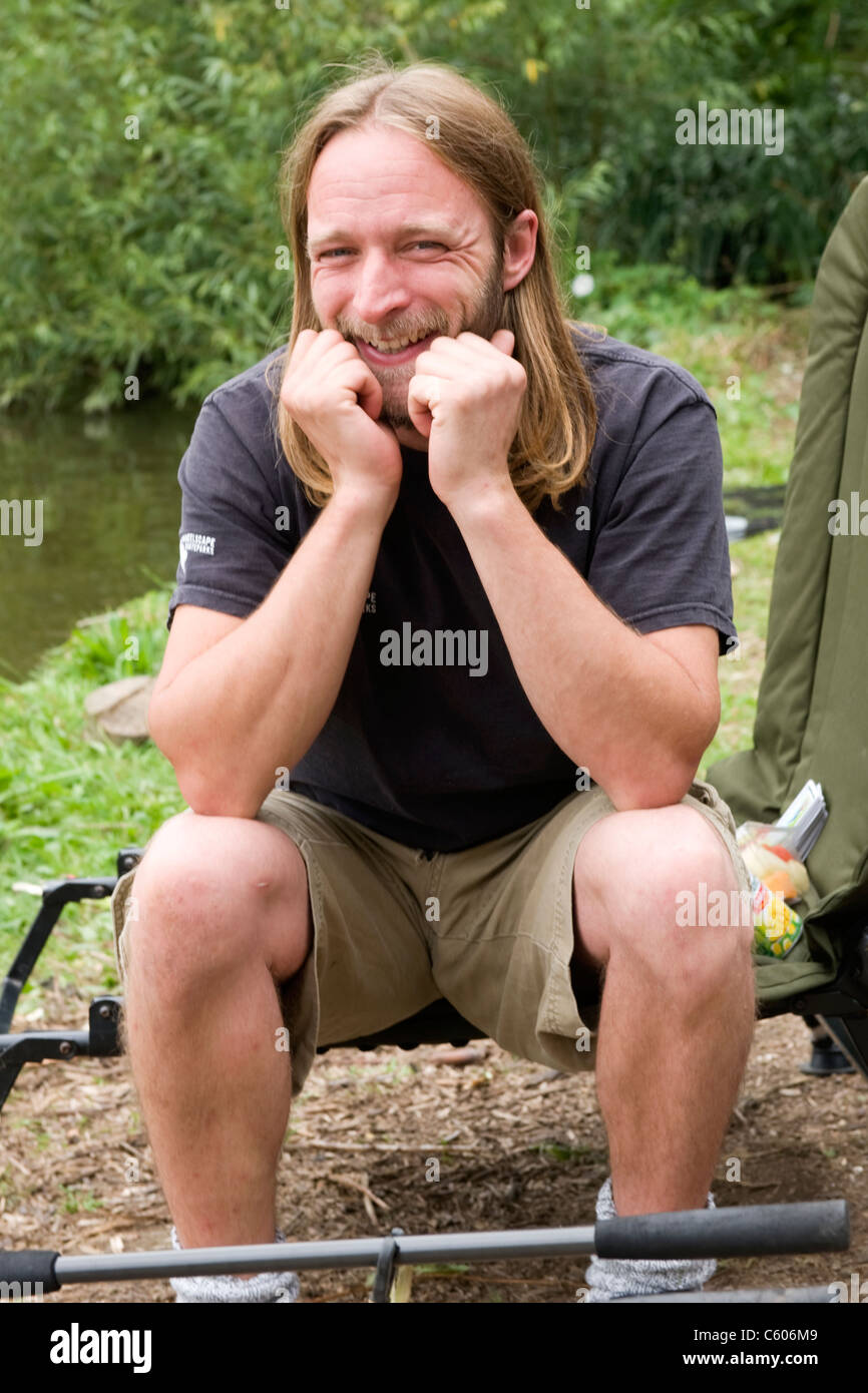 London Parliament Hill Hampstead Heath blond man with long hair beard laughing smiling happy male angler fisherman - Stock Image