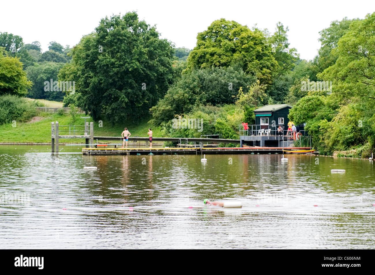 London Parliament Hill Hampstead Heath Highgate Men ' s Bathing Pond man swimming men standing on jetty pier - Stock Image