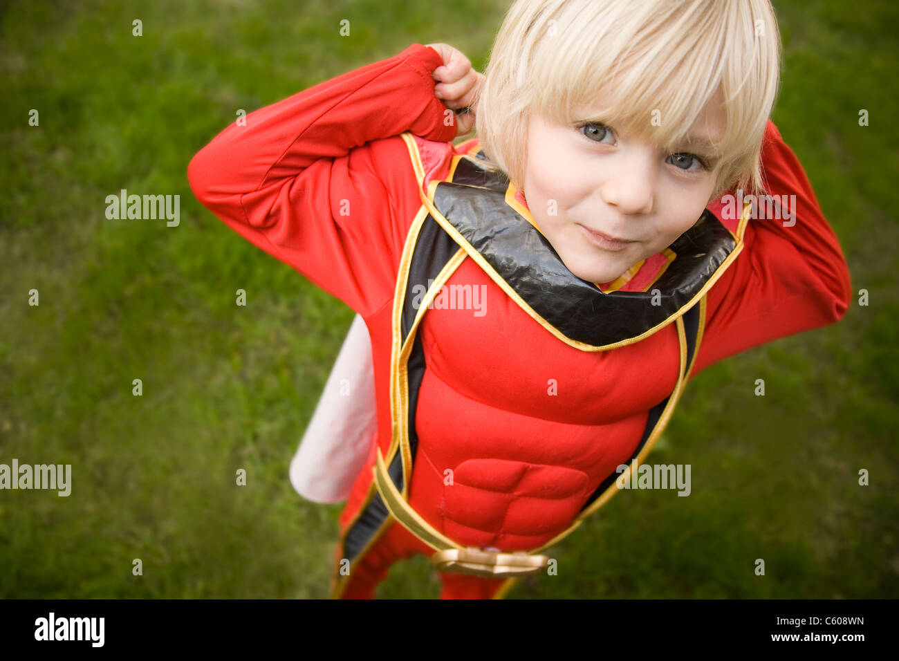 A young boy dressed as a superhero. - Stock Image