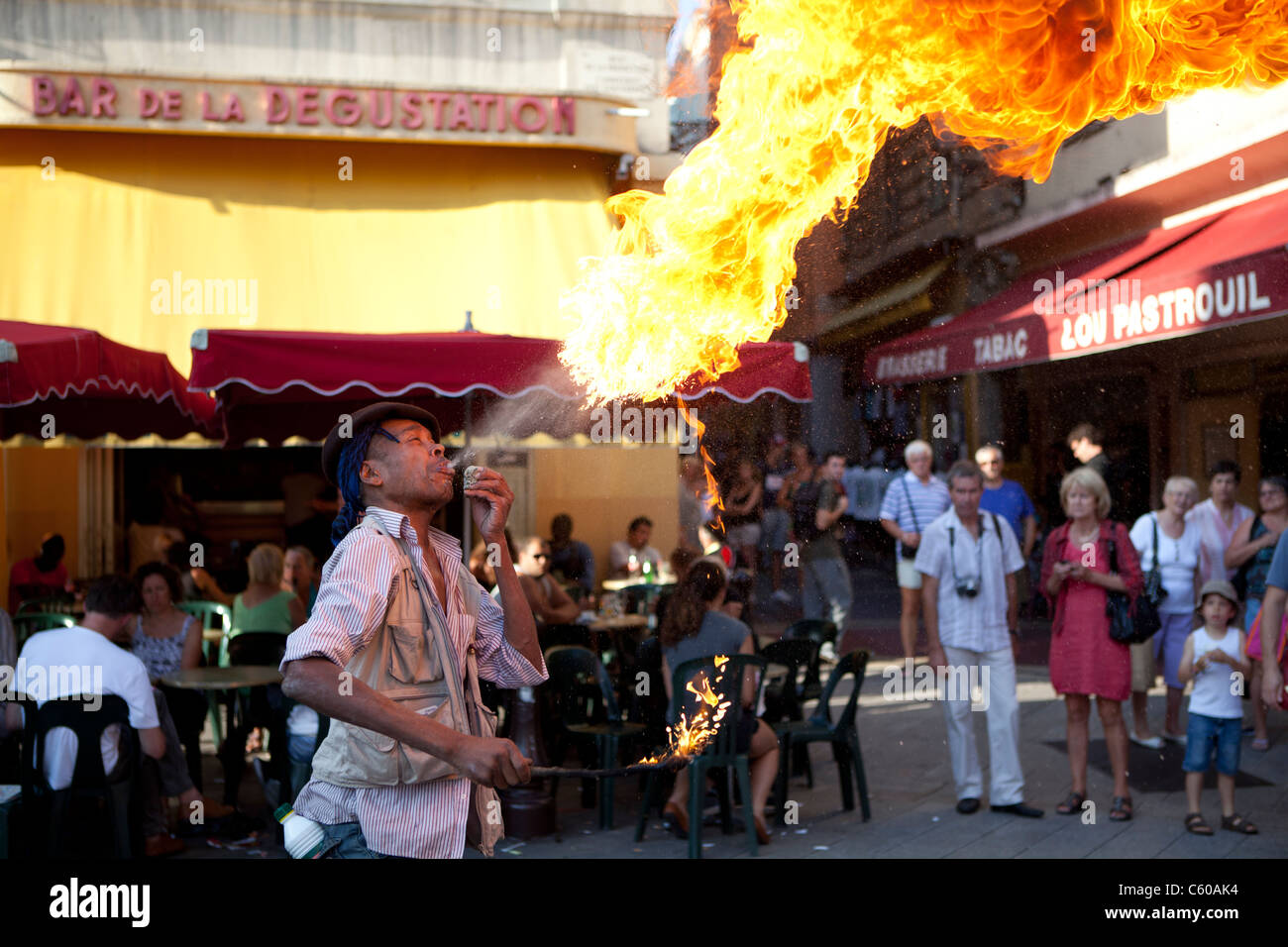 Fire breather, street entertainer, Nice, France - Stock Image