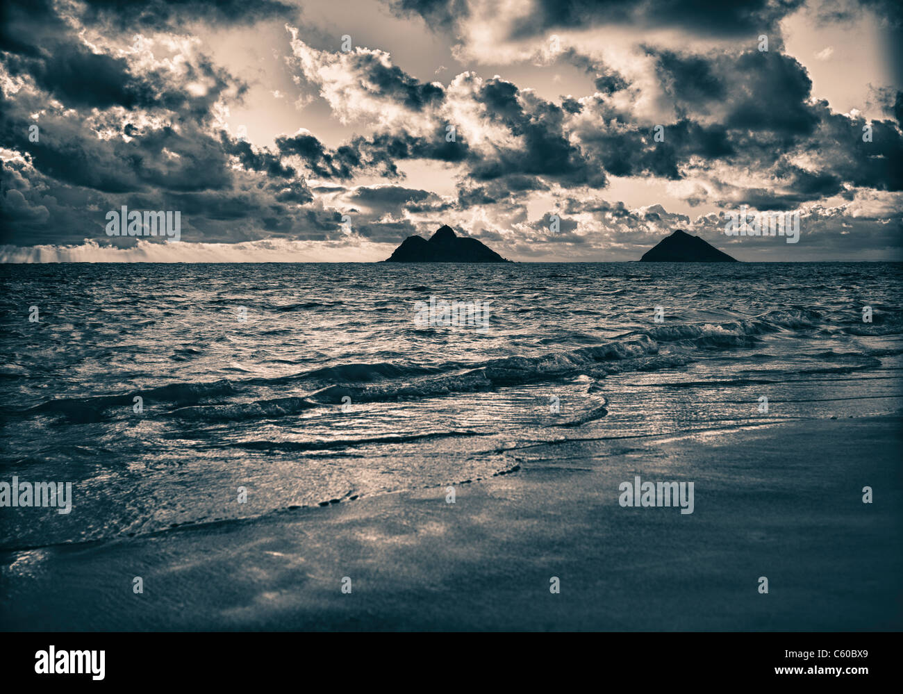 Sunrise landscape at Lanikai Beach, B&W image, dramatic clouds, Mokulua Islands in distance - Stock Image