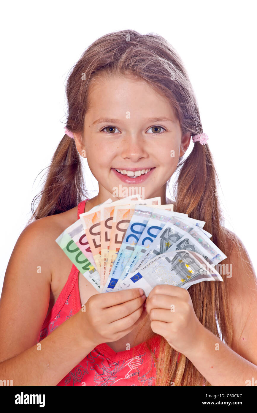 eight year old girl counts her money - Stock Image