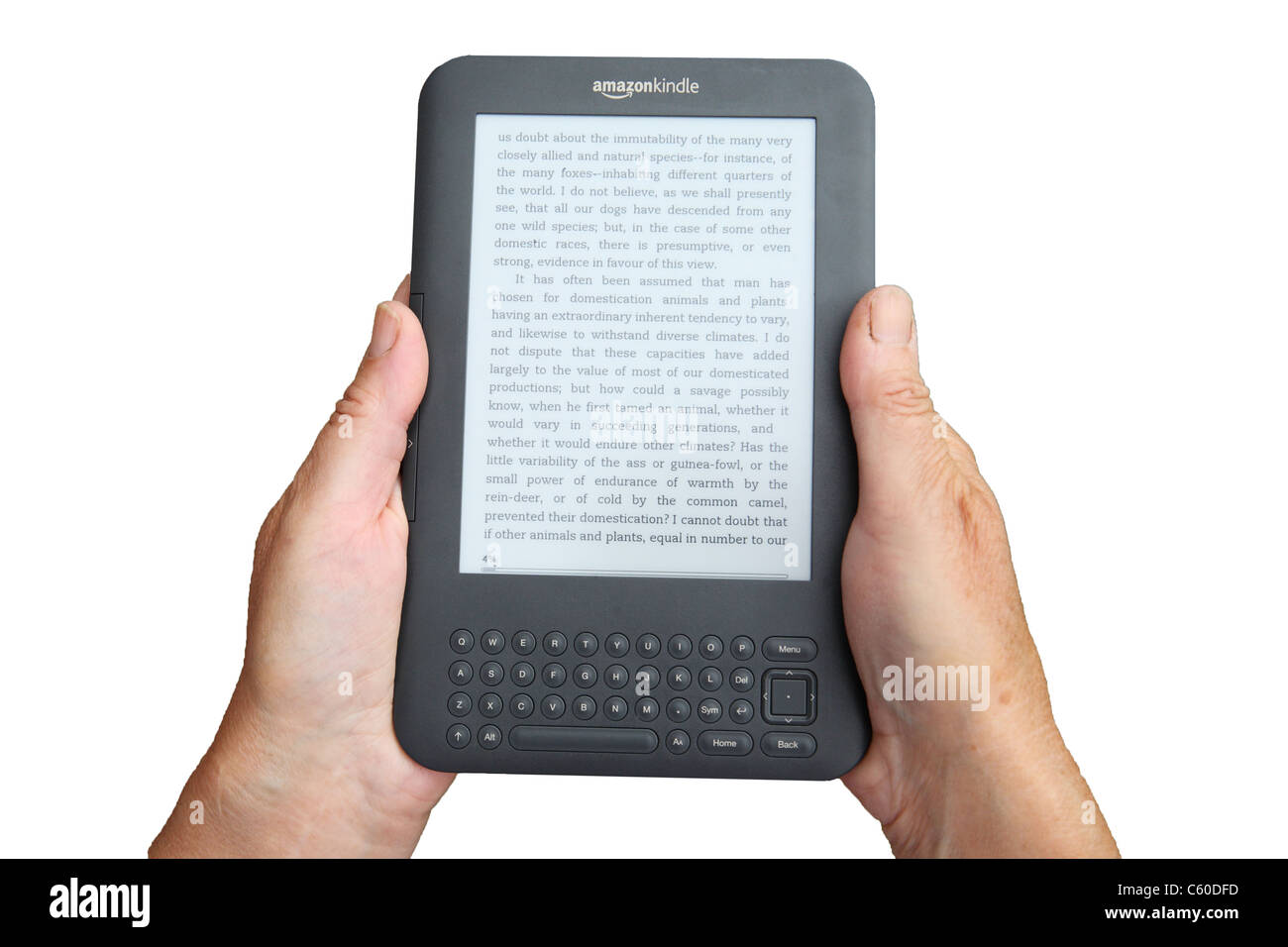 An Amazon Kindle E-book reader held within a woman's hands  isolated on white background - Stock Image