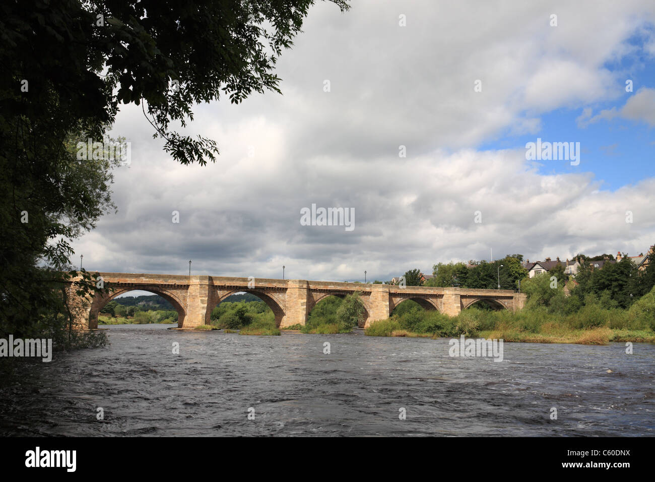The 17th century seven arched stone bridge over the river Tyne at Corbridge, Northumberland, north east England, Stock Photo