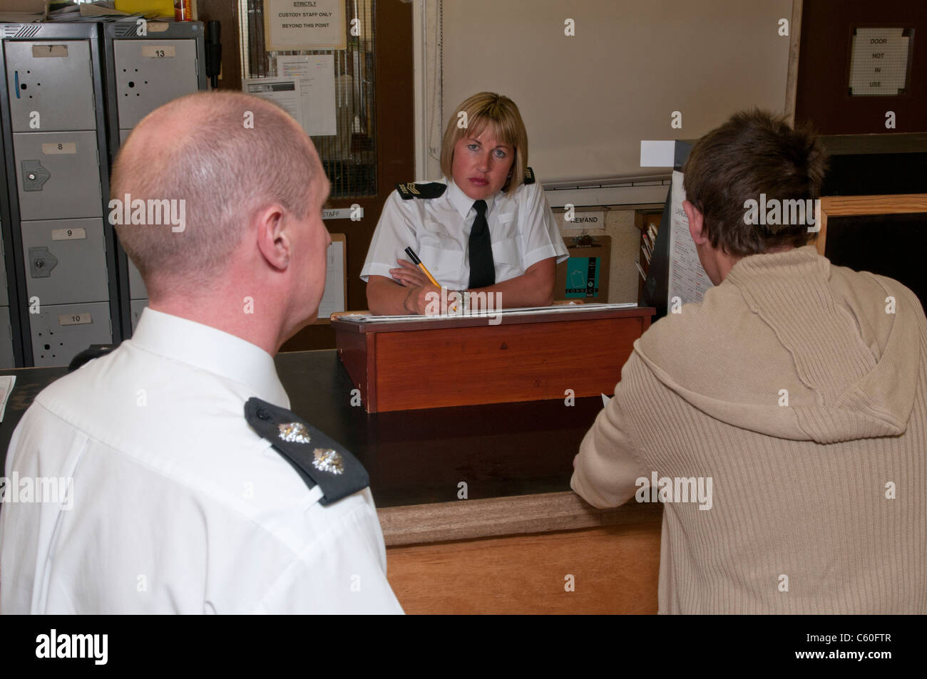Police interview white male suspect - Stock Image