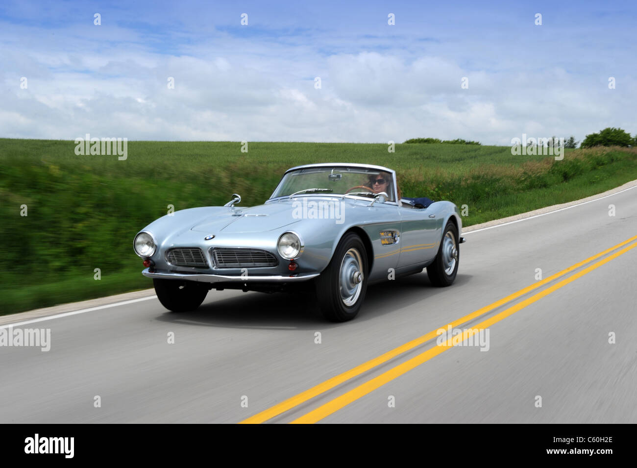 1957 BMW 507 cabriolet driving down the highway - Stock Image