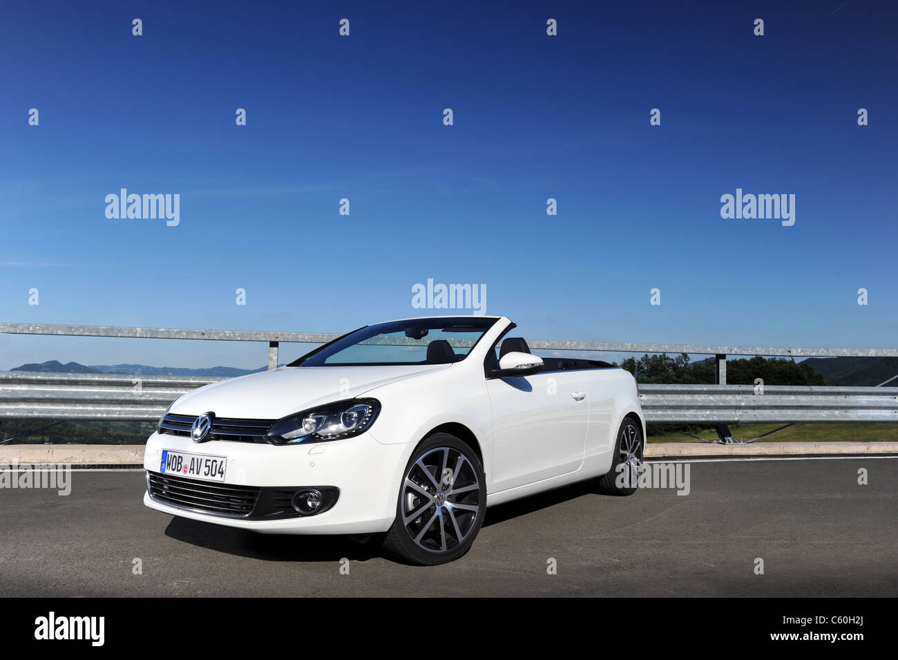 the new 2011 VW Golf Cabriolet landscape  front 3/4 shot with blue sky - Stock Image