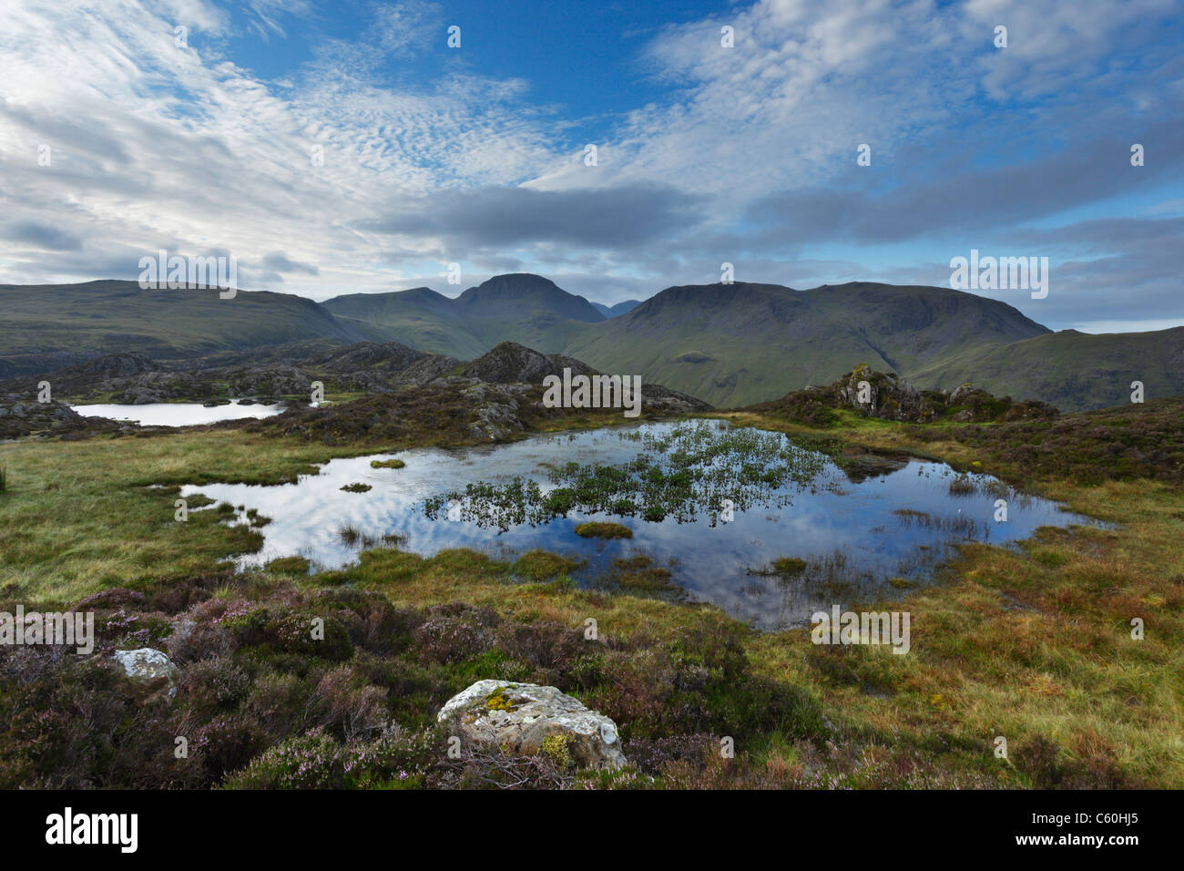Innominate Tarn on Hay Stacks with Great Gable (centre) and Kirk Fell (right) in the Distance. Lake District. Cumbria. - Stock Image