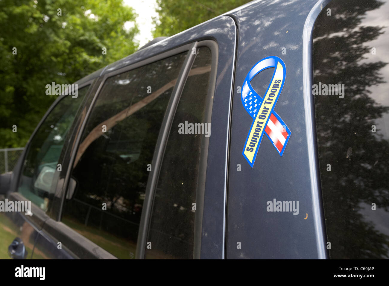 support our troops ribbon sticker on the side of an suv vehicle in the united states of america usa - Stock Image