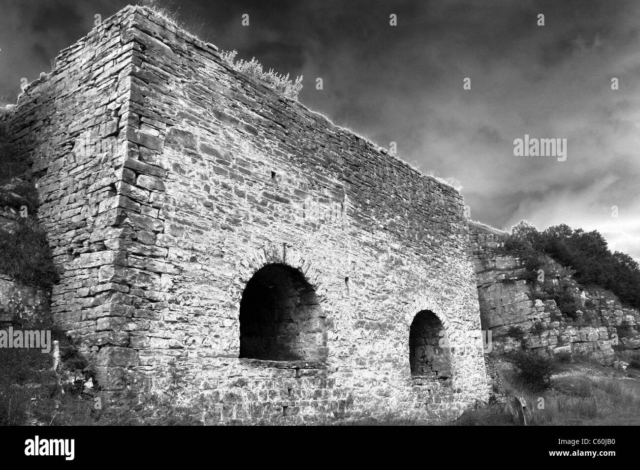 Old Lime Kilns at Smardale NNR, Cumbria, UK With A b/w Solarised Photography Effect - Stock Image