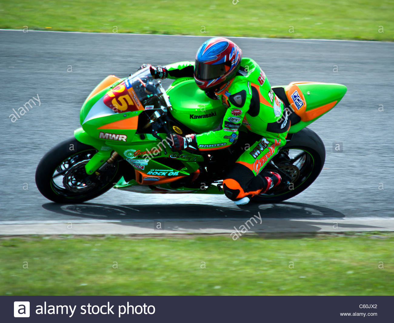 Side view of a rider in the British superbike races, racing at croft circuit, Darlington,England,UK. - Stock Image