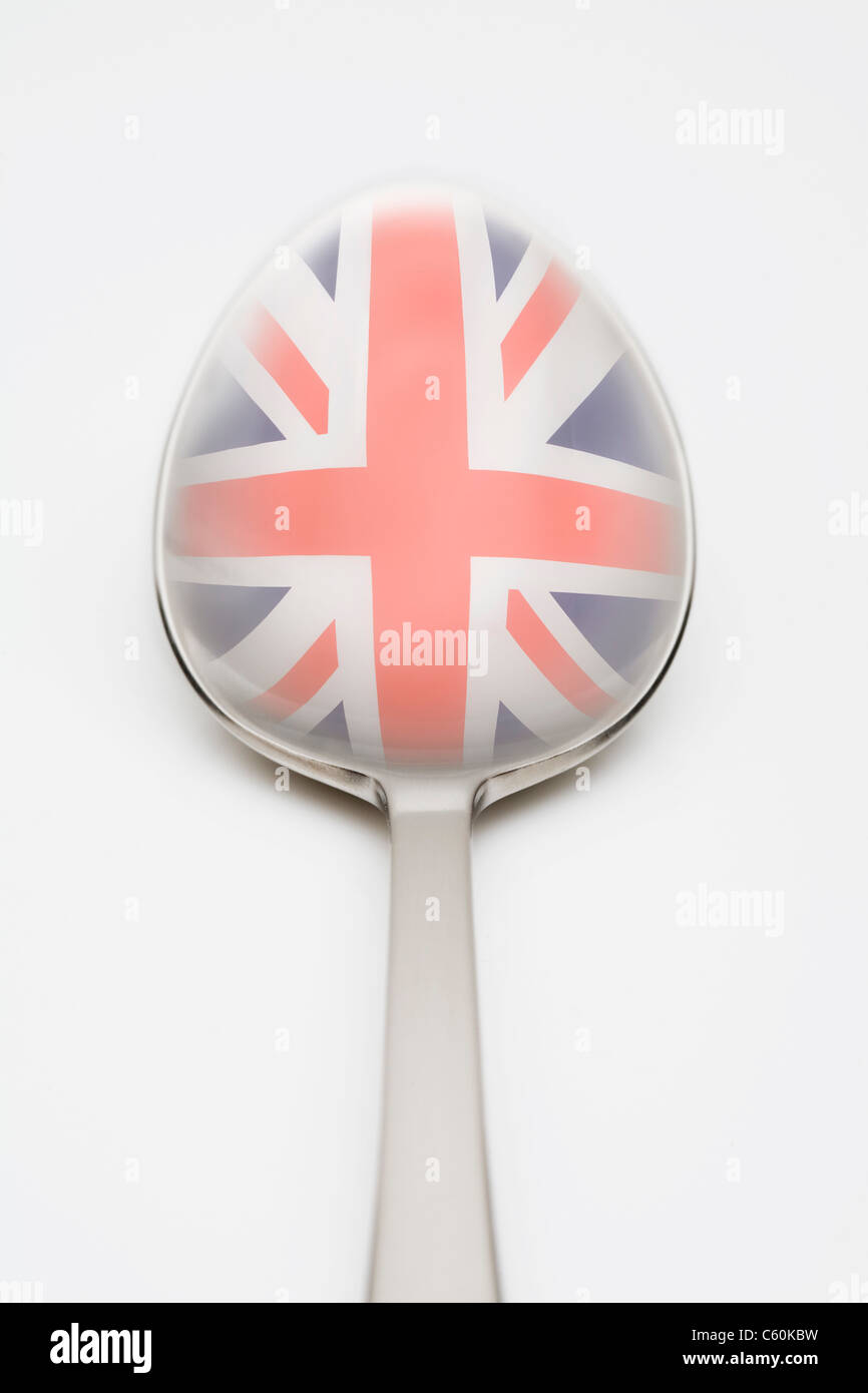 British flag reflected in spoon - Stock Image