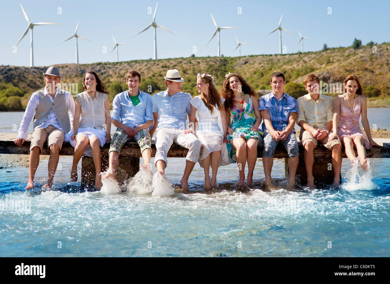 Friends kicking water from deck - Stock Image