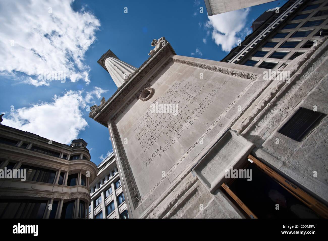 Monument on city street against blue sky Stock Photo