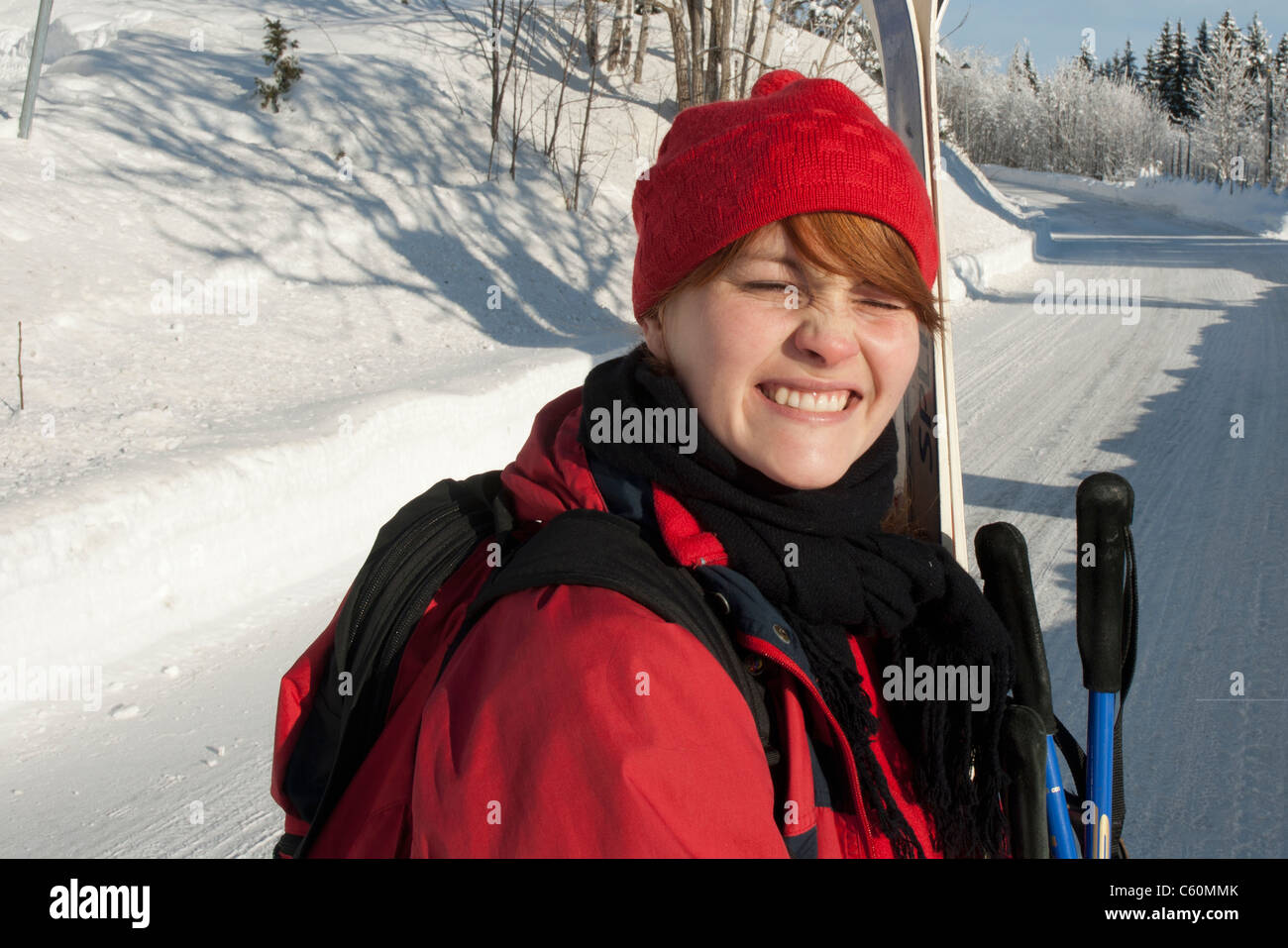 Woman riding ski lift - Stock Image