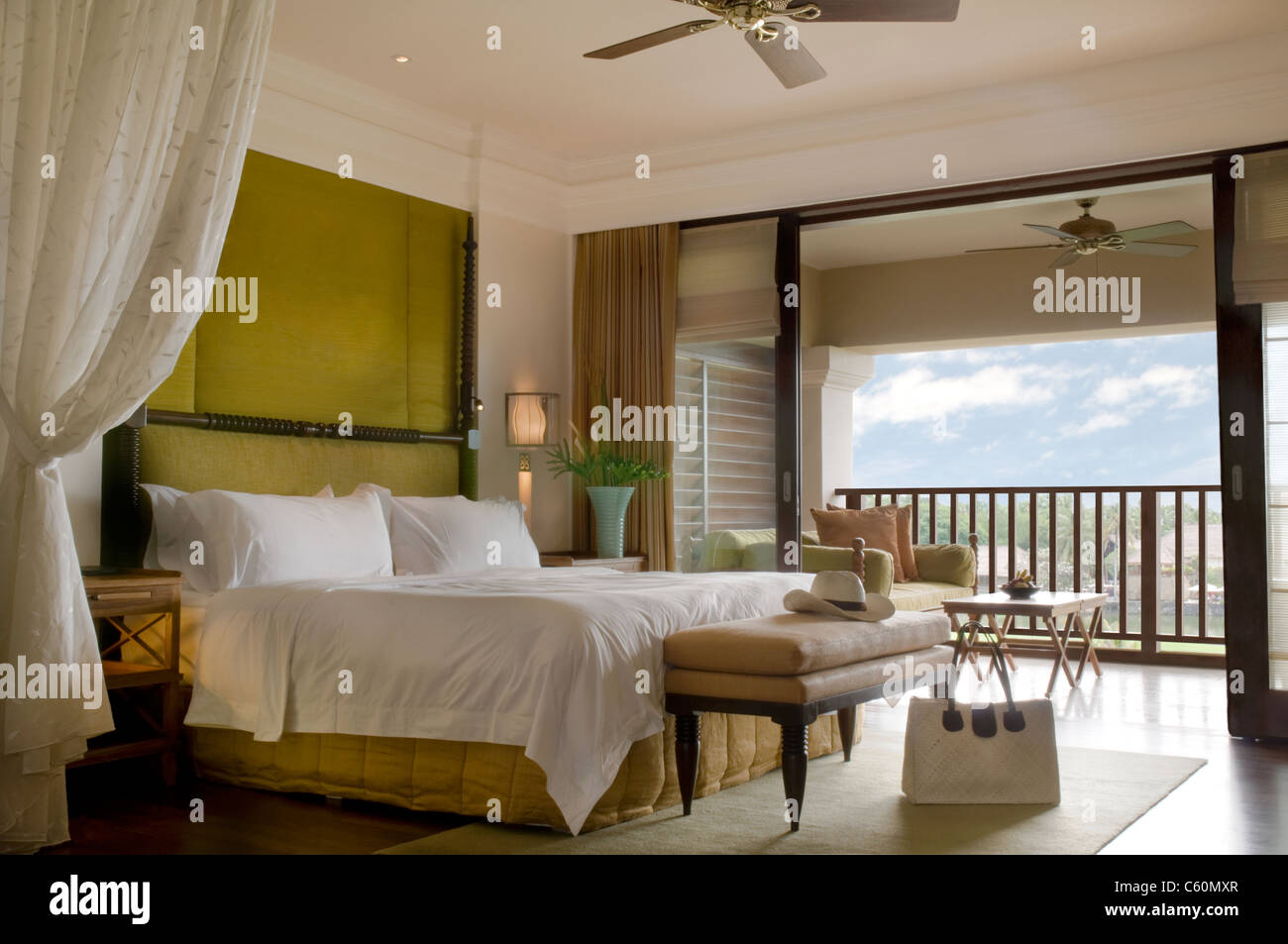 Suite bed room with balcony of a luxury resort on a sunny day - Stock Image