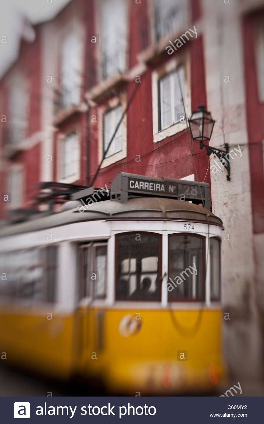 Blurred view of streetcar on city street - Stock Image