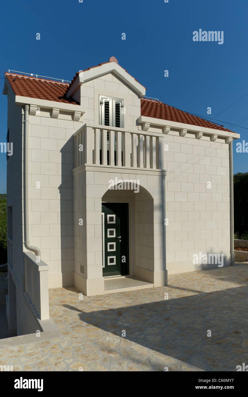 House of white stone - Stock Image