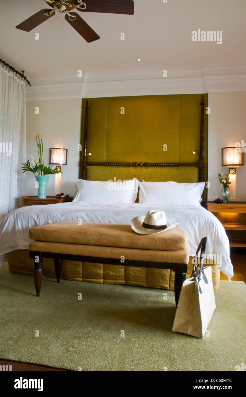Suite bed room of a luxury resort with ceiling fan - Stock Image