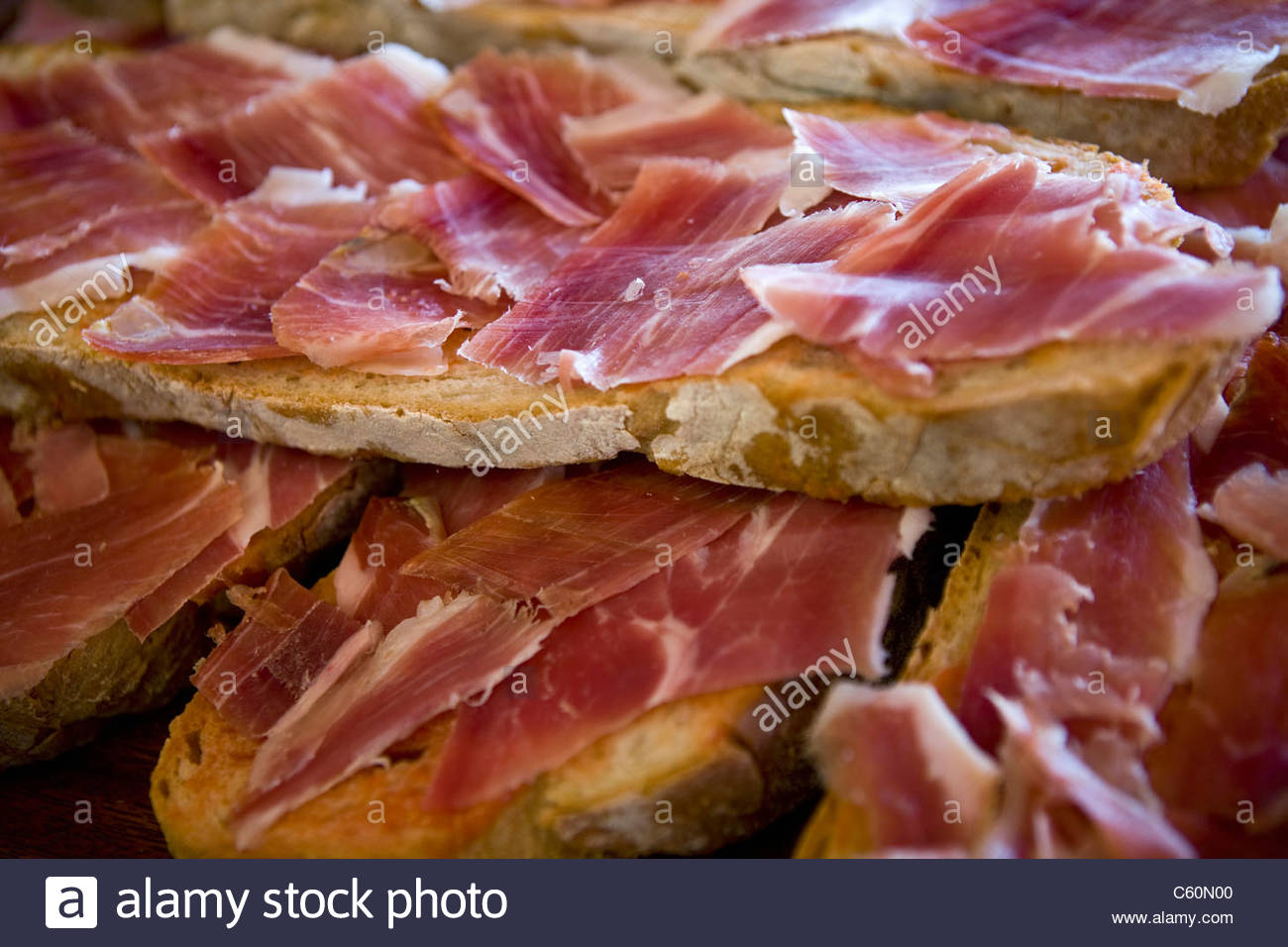 Slices of ham and bread - Stock Image