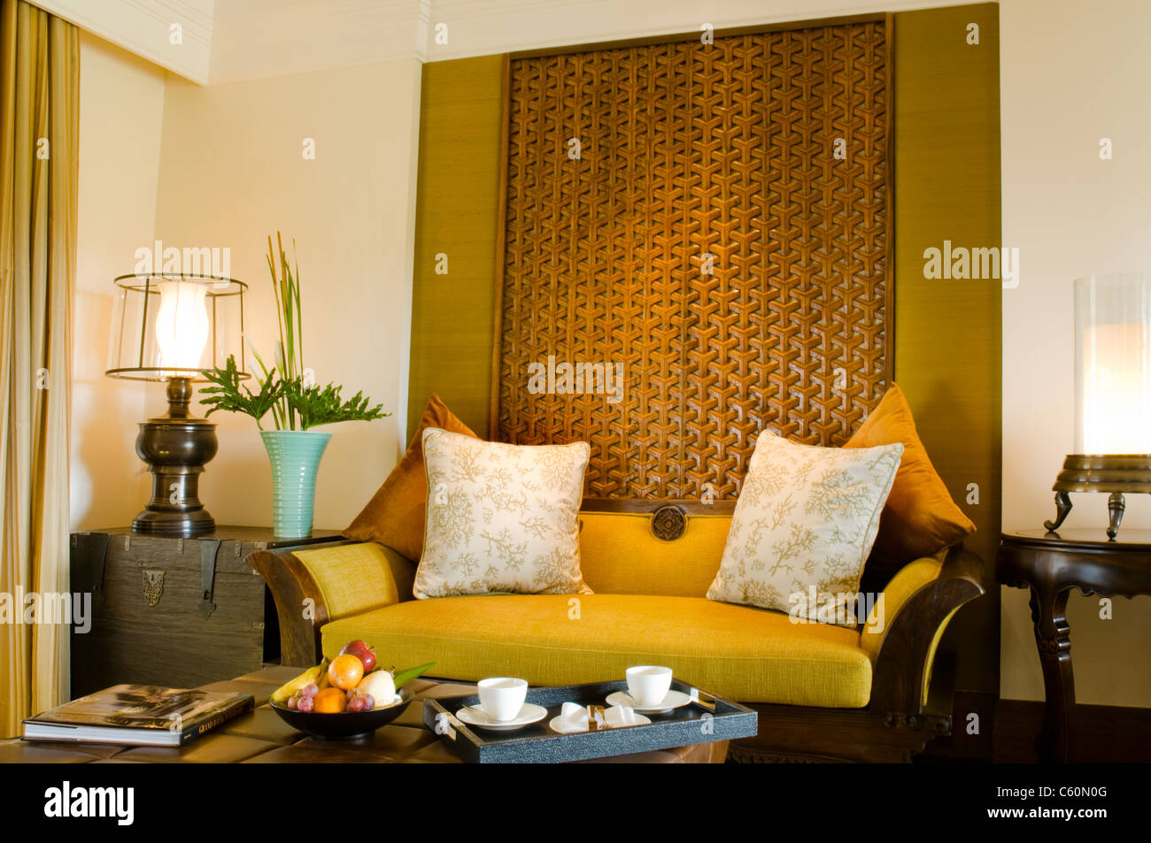 Contemporary living area resort hotel suite room with fruits and tea - Stock Image