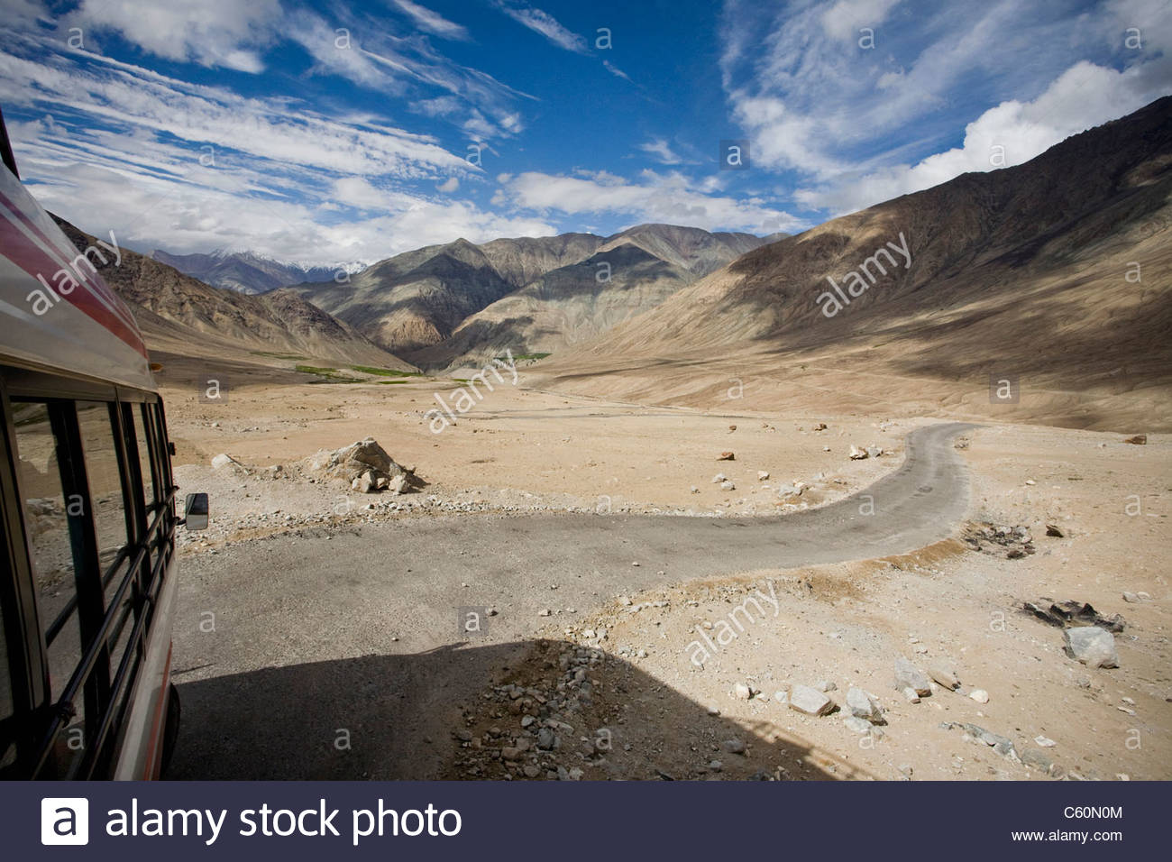 Rural road through desert and mountains - Stock Image