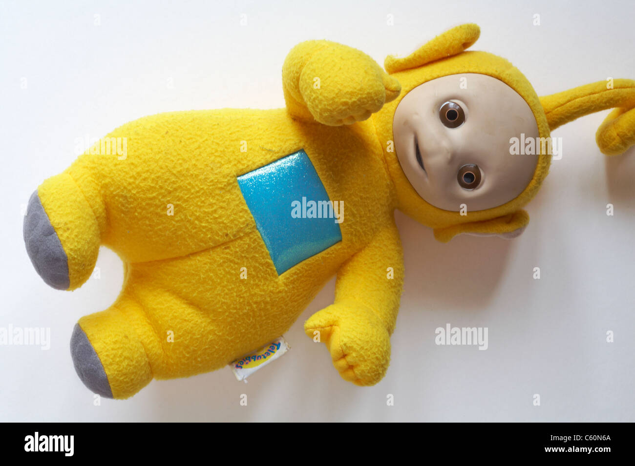 Well loved cuddly Laa-Laa teletubby doll on white background - Stock Image 89b0730b10fc