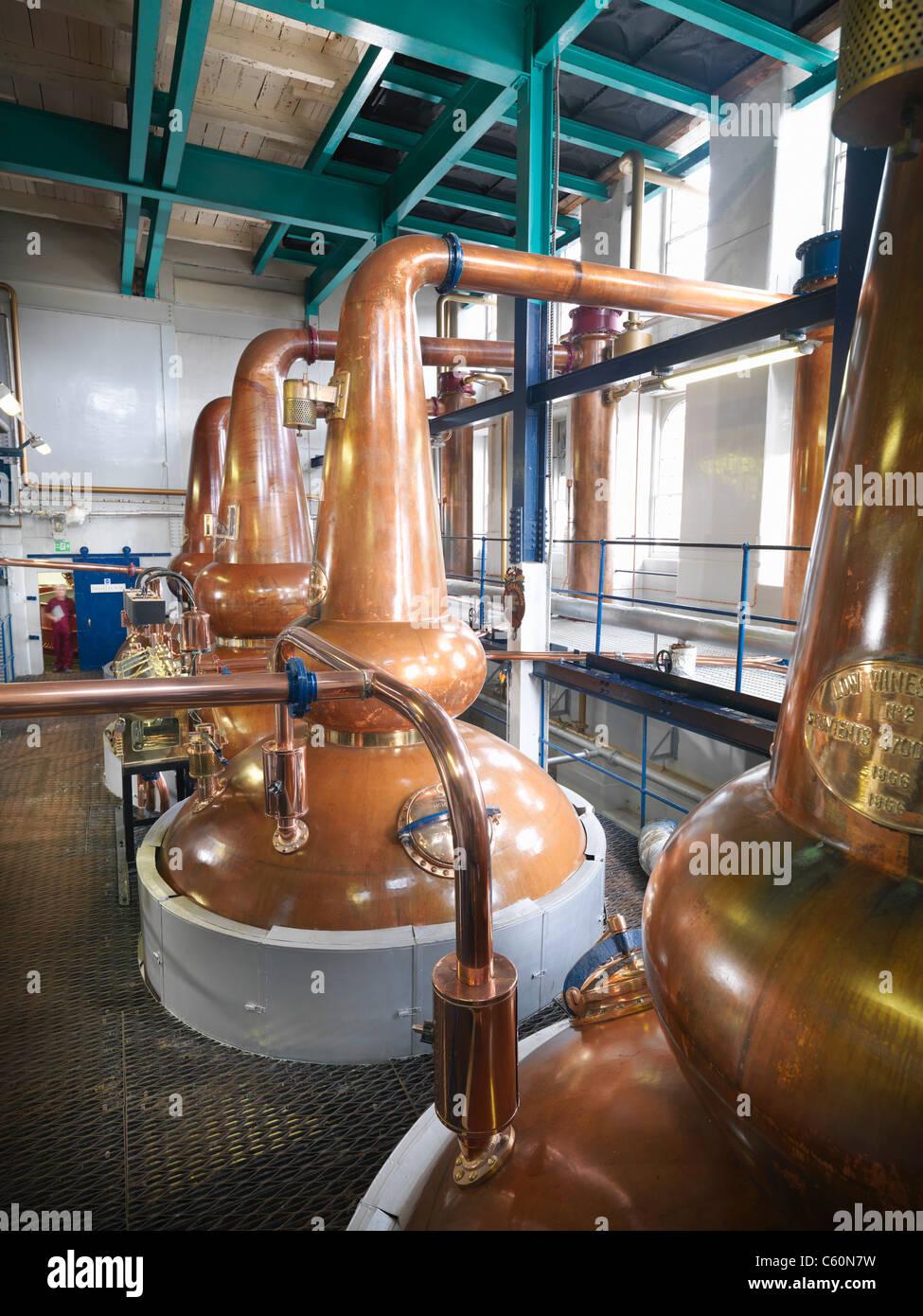 Whisky stills in distillery - Stock Image