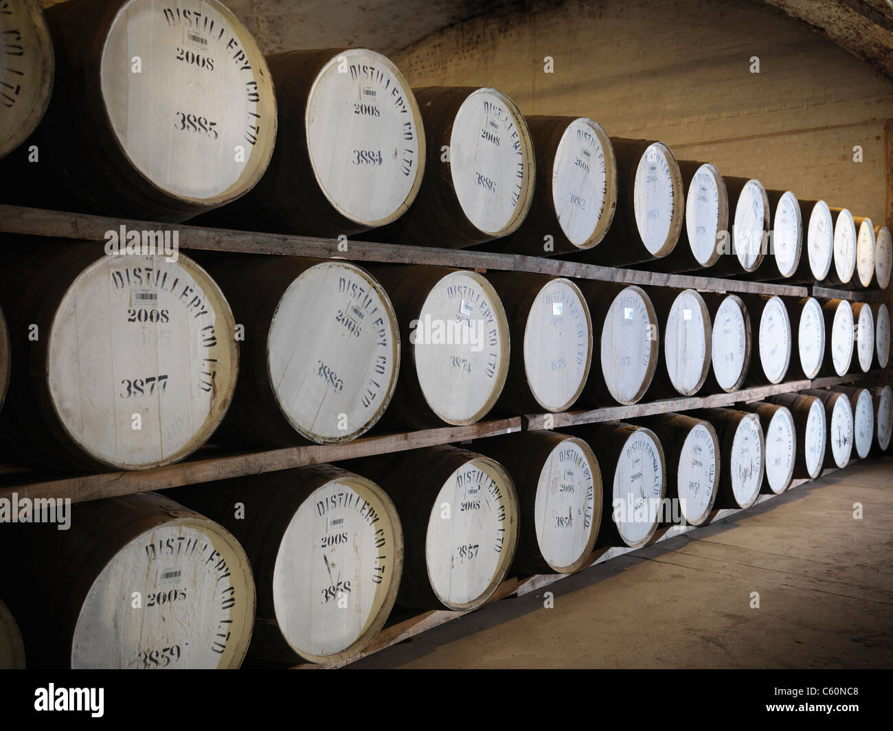 Barrels of whisky in distillery - Stock Image
