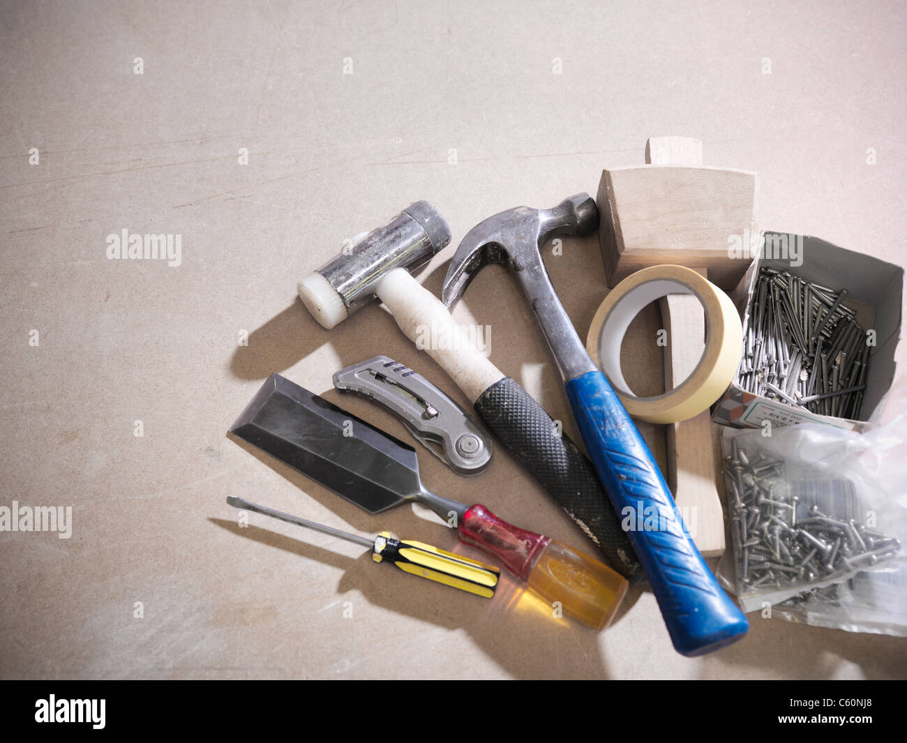 Assorted tools on work surface - Stock Image