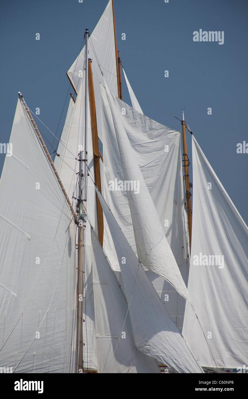 close up of sails on older wooden boat schooner Stock Photo