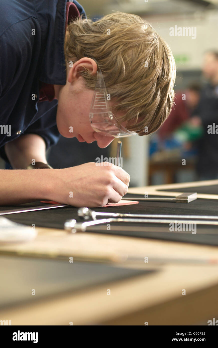 Worker tracing on countertop - Stock Image