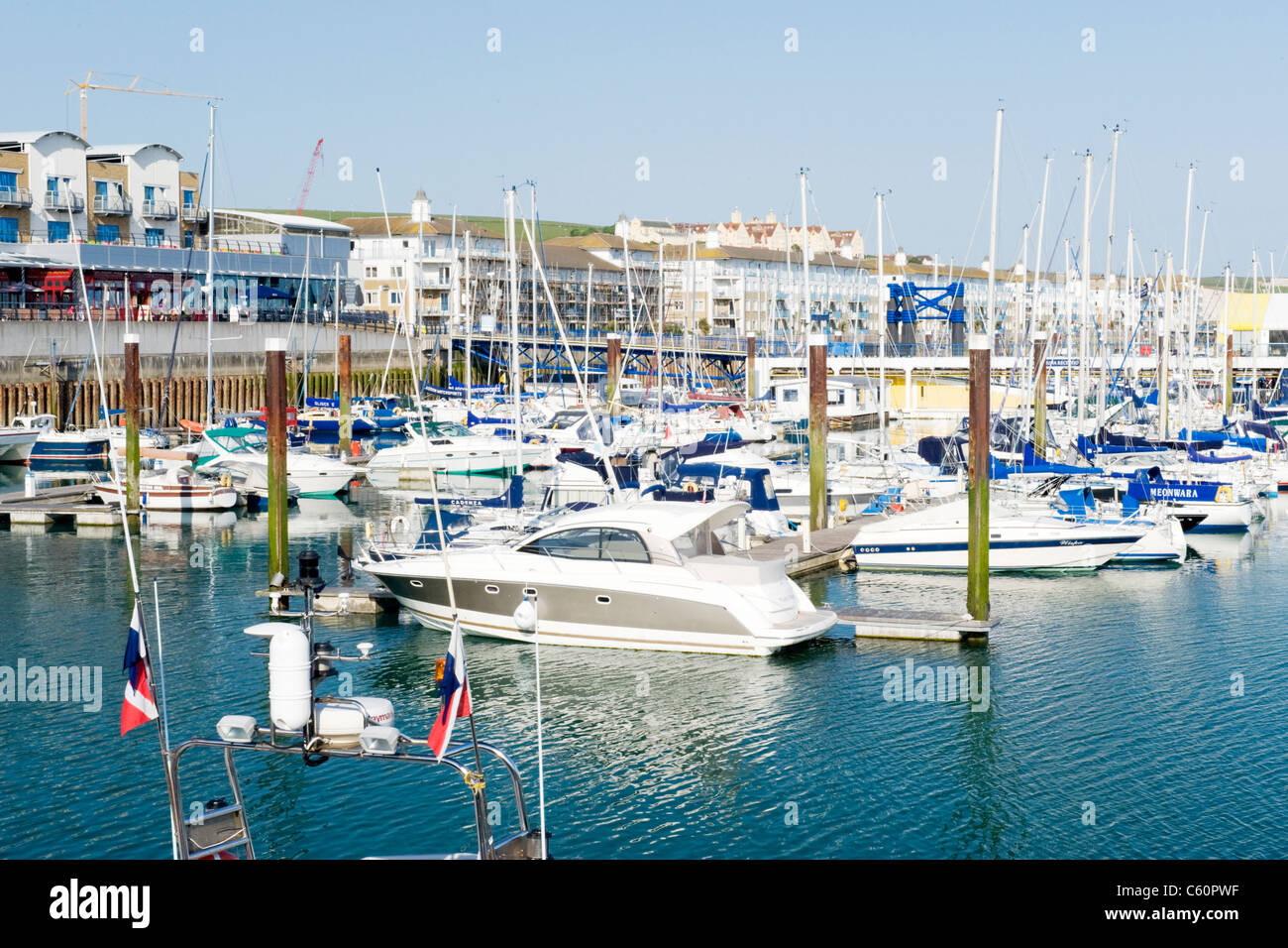 Brighton Marina , East Sussex , motor & power boats at moorings - Stock Image