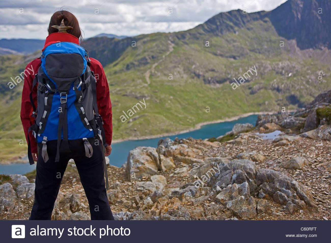 Hiker overlooking landscape - Stock Image