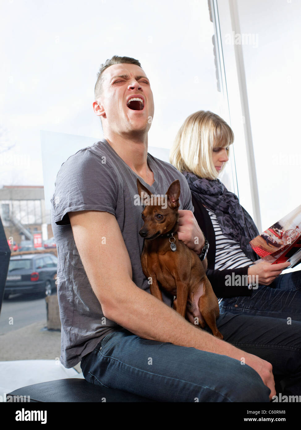 Man howling with his dog - Stock Image