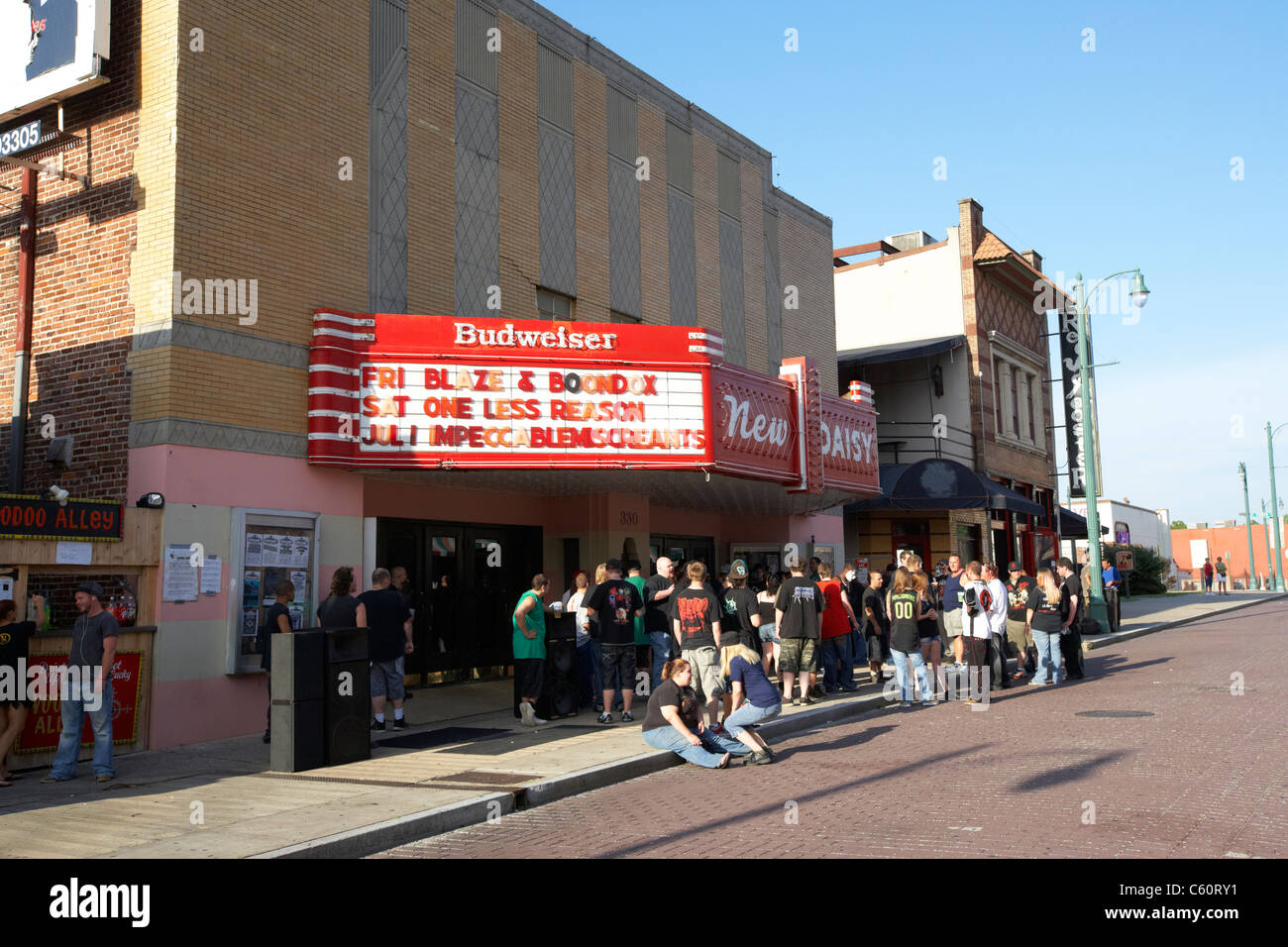 crowd of young tourists drinking outside the new daisy theater beale street memphis tennessee united states america - Stock Image