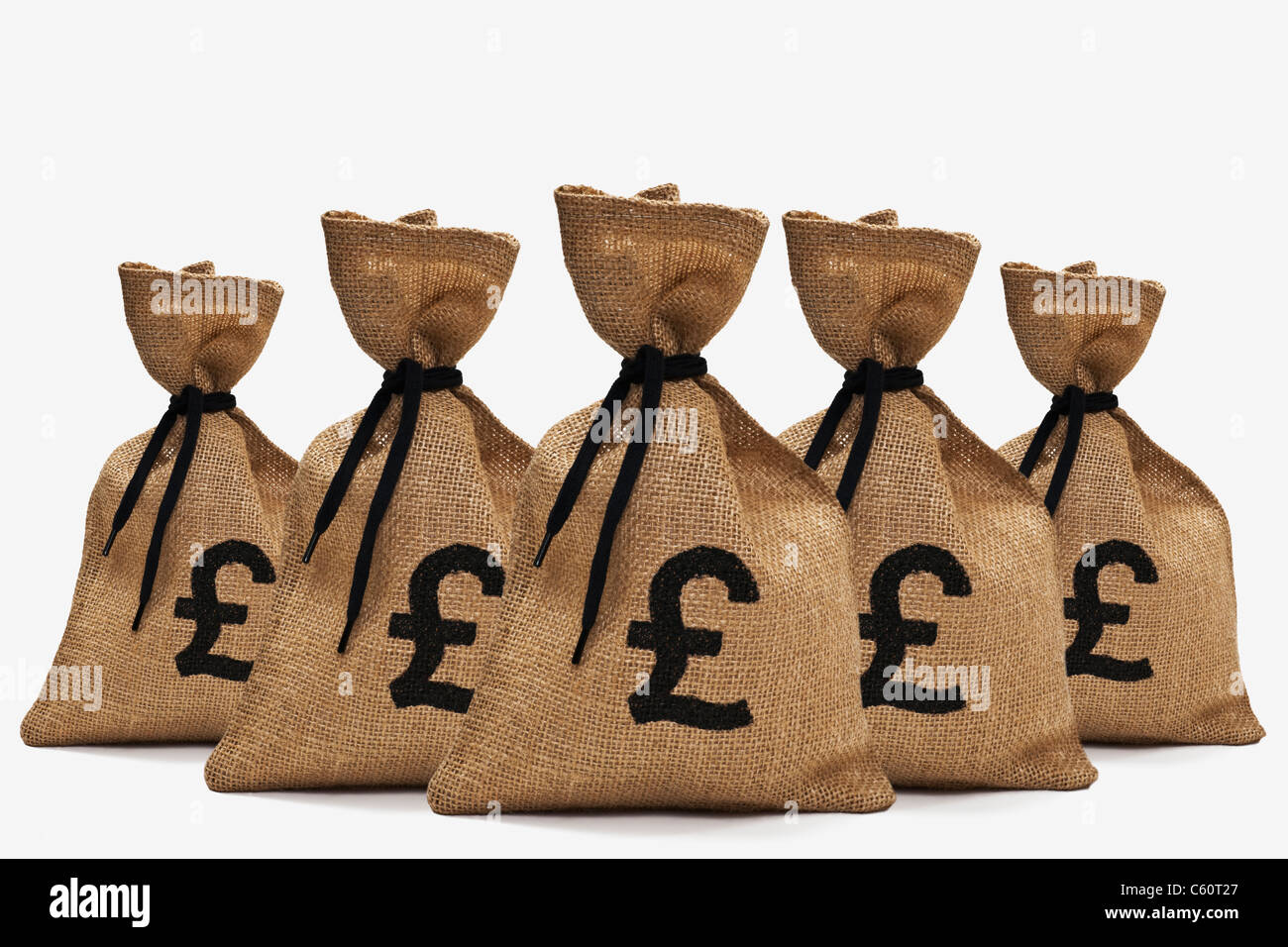 fünf Geldsäcke mit Pfund-Symbolen stehen hintereinander | five money bags with pound signs back-to-back Stock Photo