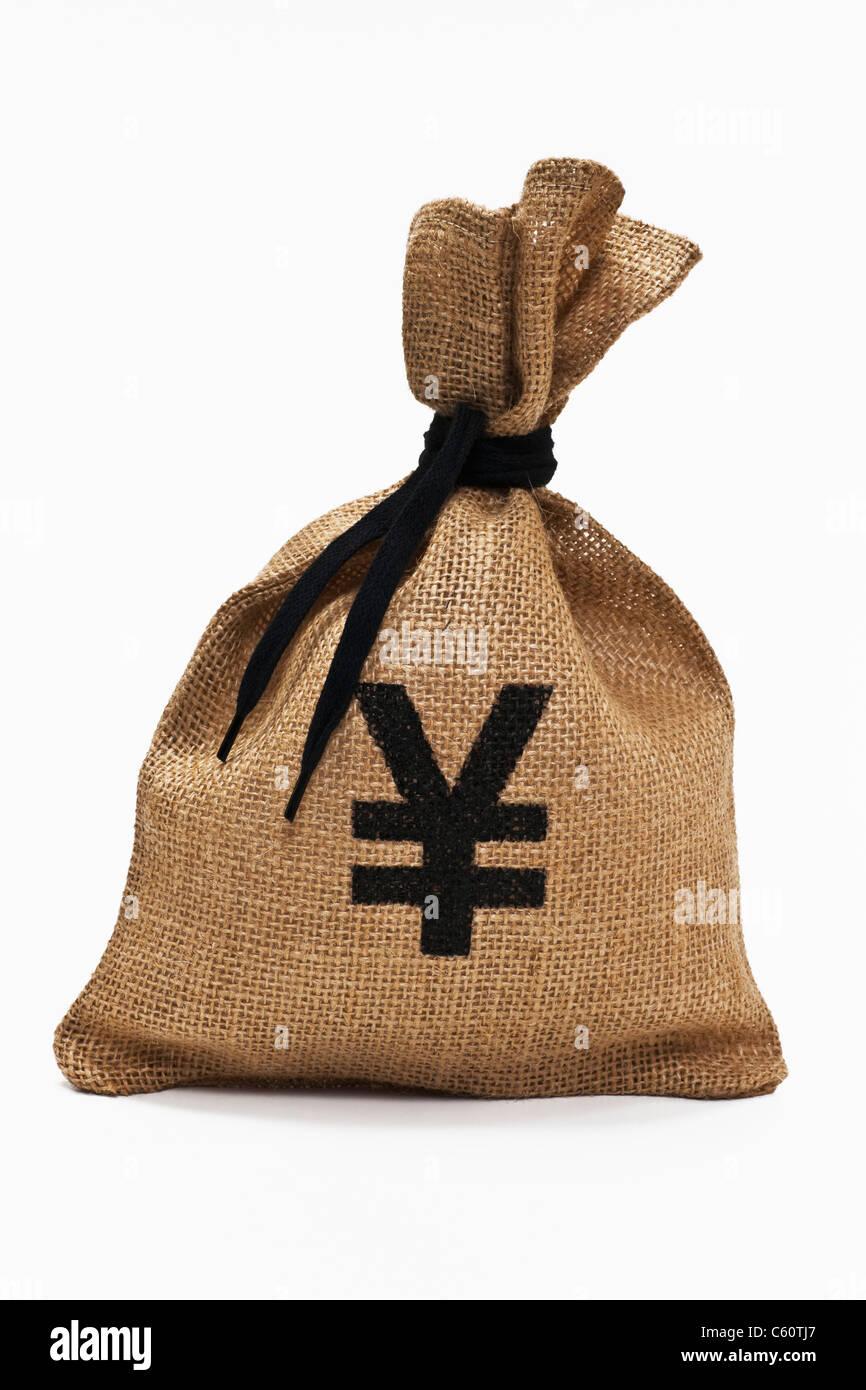 Detailansicht eines Geldsackes mit Yen-Symbol | Detail photo from a money bag with yen sign - Stock Image