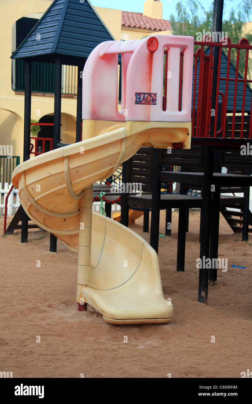 A childs slide at a fun park - Stock Image