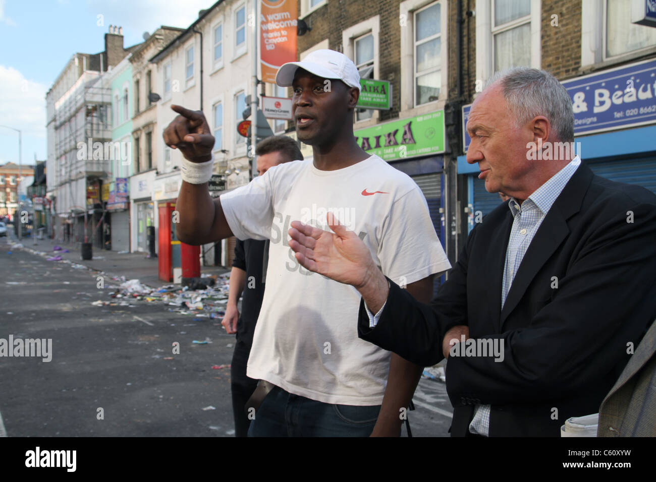 Labour Party candidate for Mayor of London Ken Livingstone inspects damage by looters in Croydon.UK - Stock Image
