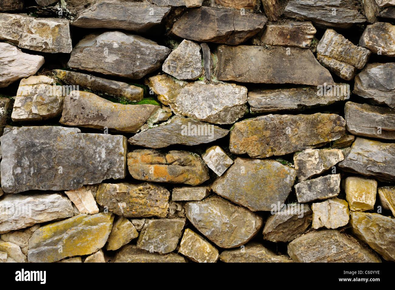 Wall of natural non-masonry rock - Stock Image