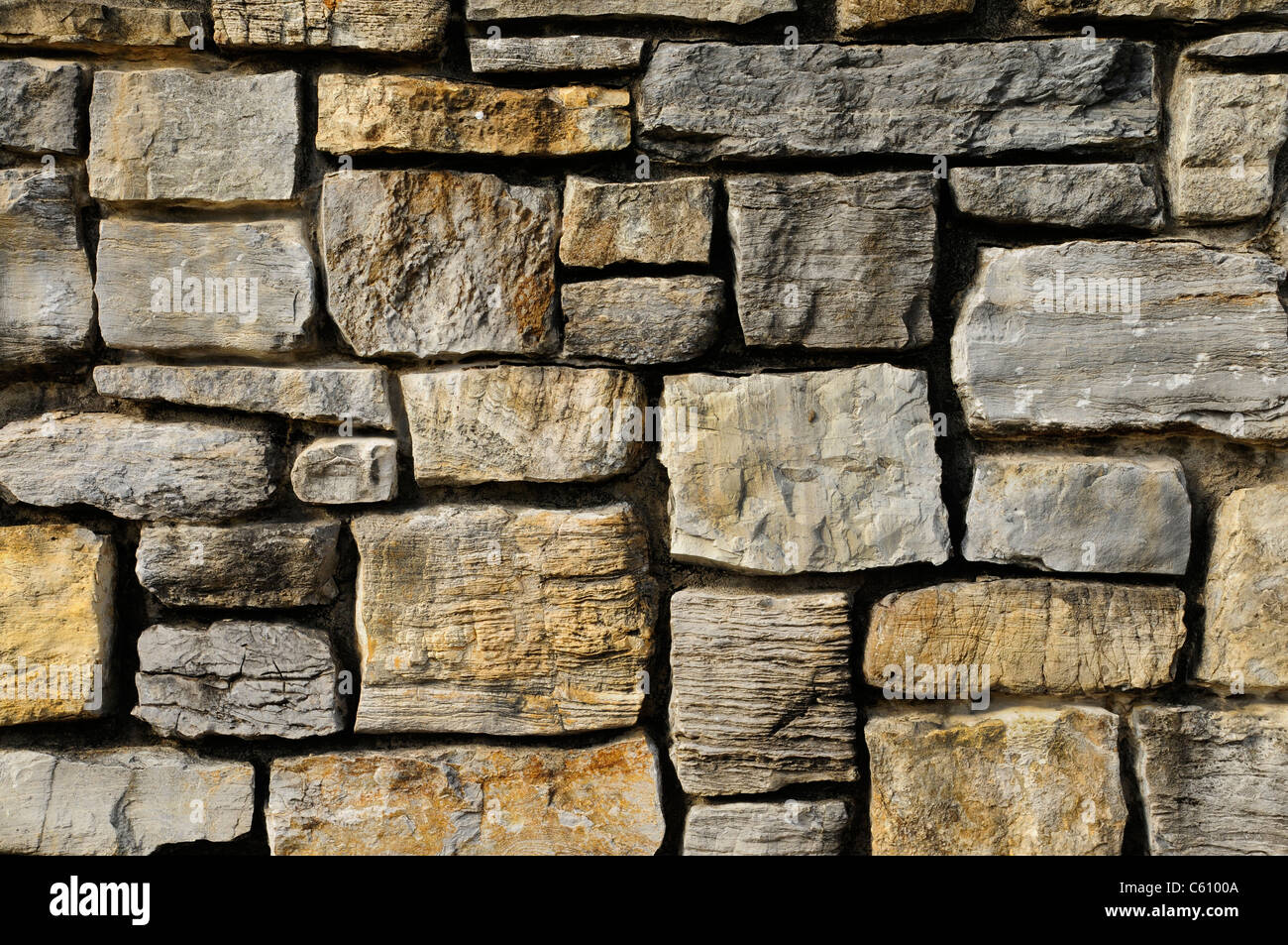 Rough masonry rock wall texture - Stock Image