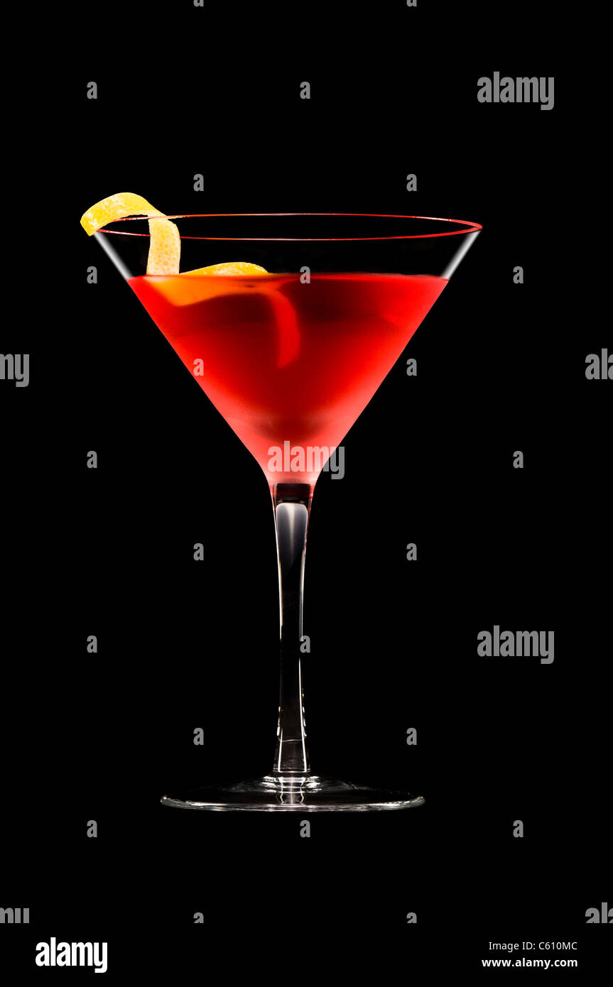 Cosmopolitan cocktail in nice red color in front of a black background - Stock Image