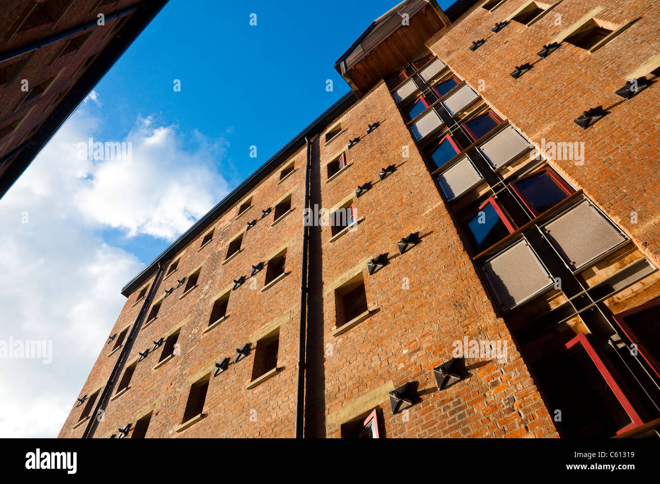 Gloucester Docks - warehouses converted to residential apartments / flats. Gloucestershire, UK. - Stock Image
