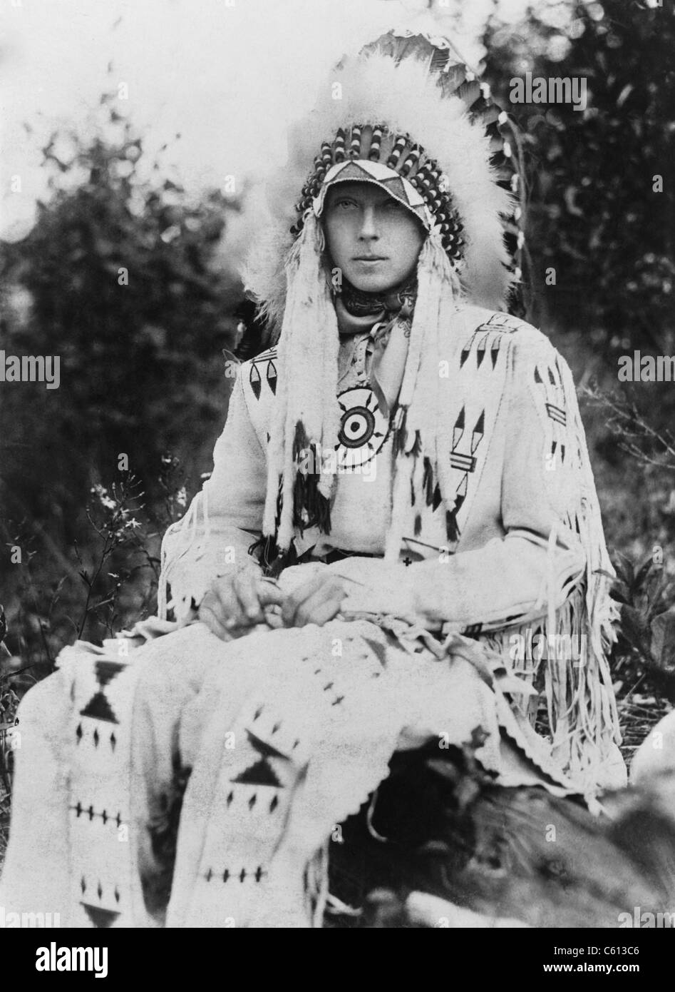 Britain's King Edward VIII as Prince of Wales, wearing the headdress of a Native American chief during a visit - Stock Image