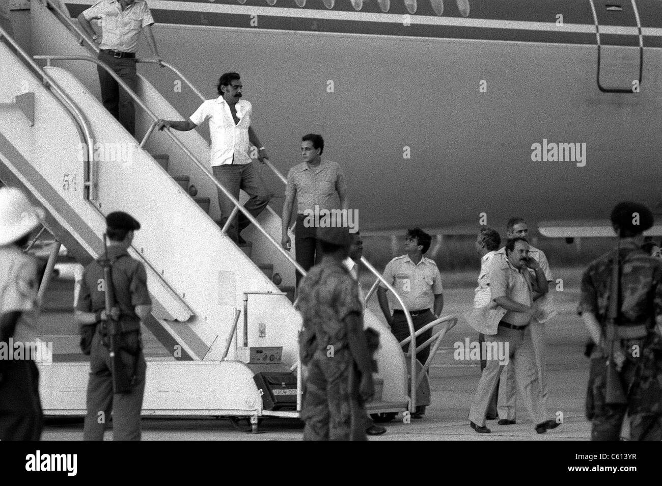 U.S. Air Force security police guard Cuban nationals as they board the airliner returning them to Cuba. Grenada's - Stock Image